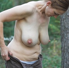 Mature with big beautiful saggy breasts.