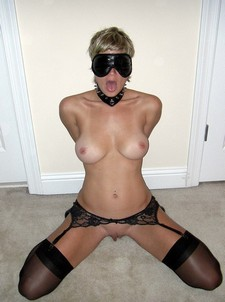 Blindfolded wife with hands behind her back is waiting for your dick.
