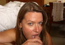 Middle-aged beauty licking a dickhead in front of camera