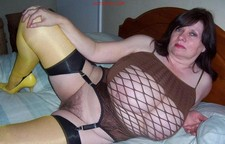 Huge titted granny posing naked