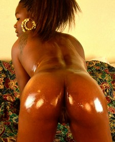 Oiled Black Booty. Horny naked ebony has a well oiled up black ass