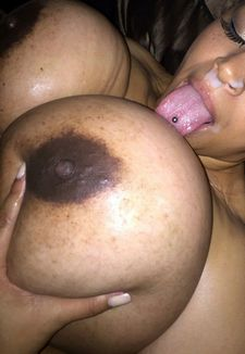 Covered by cum ebony lady licks her huge boobs