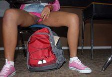 Ebony teen exposes pussy in class.