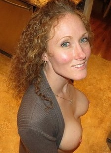 Sexy Ashton shows us her blue eyes and perky breasts.