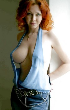 Mystery redhead with awesome breasts.