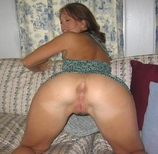 Sexy MILF with her shaved pussy and ass high in the air.
