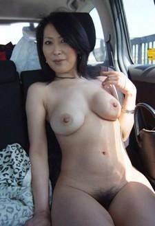 Asian milf nude in the car.