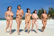 Run boobies run! Busty brunettes shaking their huge tits on the beach