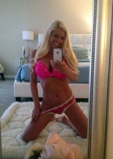 Hot blonde in pink lingerie selfie