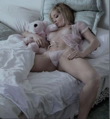 That Teddy bear is totally copping a feel!.