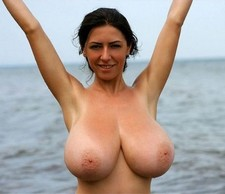 Boobed woman on the free beach