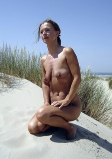 Small Tits Blonde Nude Beach Pic