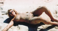 Mature wife posing on the beach